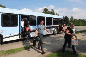 Passengers Getting off bus at Friday Center