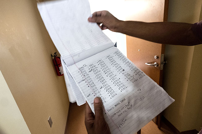 Housekeeping zone manager Martin Chavious logged handwritten notes in a legal pad, filling its pages with neat columns of the room numbers of the five buildings his team maintained.