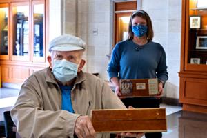 Wilson displays the piece of Woollen Gym flooring
